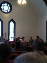 A baptism taking place