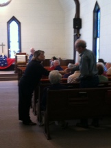 Pastor recognizing a veteran